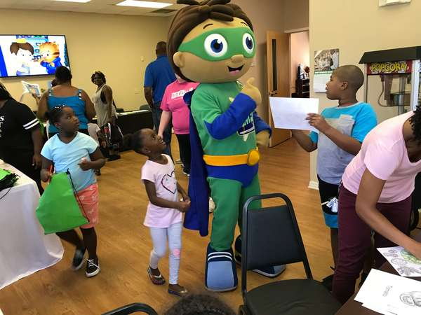Wyatt Beanstalk from Super Why speaking with a group of children